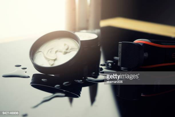 electronic shaving with cream aftershave  on wet background