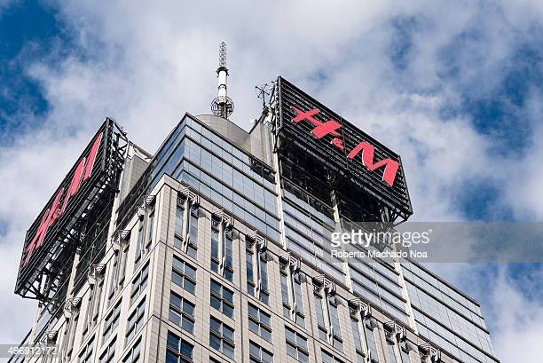 M electronic signboards on top of a high rise building in New York city Hennes Mauritz AB is a Swedish multinational retailclothing company known for...