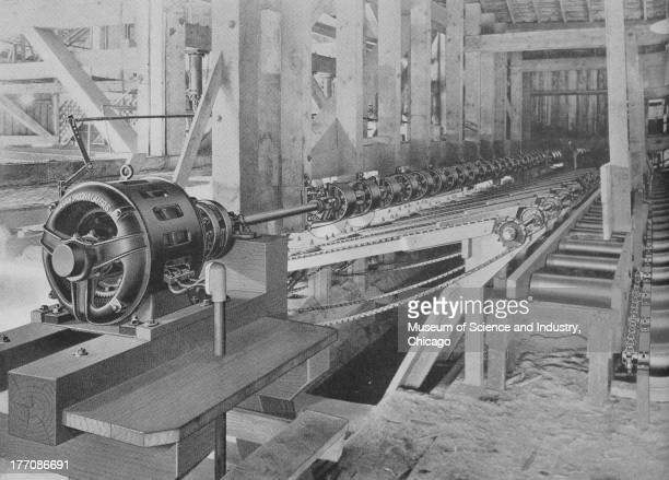 Electronically Driven Saw Mills Cut 17272 black and white image of the interior of a sawmill showing a long Pacific Coast Overhead Trimmer 1922