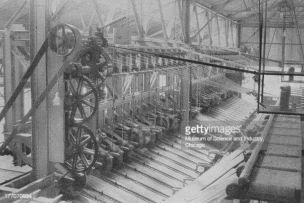 Electronically Driven Saw Mills Cut 9247 black and white image of the interior of a sawmill with two AllisChalmers Motordriven Overhead trimmers...