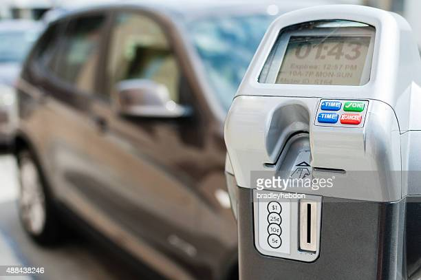 electronic/digital parking meter with time left - parking meter stock photos and pictures