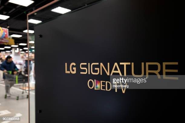 LG Electronics Inc branding is seen on a organic lightemitting diode television at an EMart Inc Electro Mart store in Gimpo South Korea on Friday Jan...