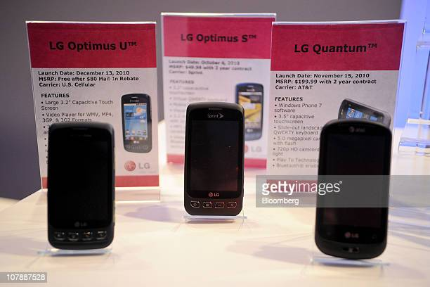 LG Electronics Inc smartphones including the Optimus U Optimus S and Quantum sit on display during the 2011 International Consumer Electronics Show...