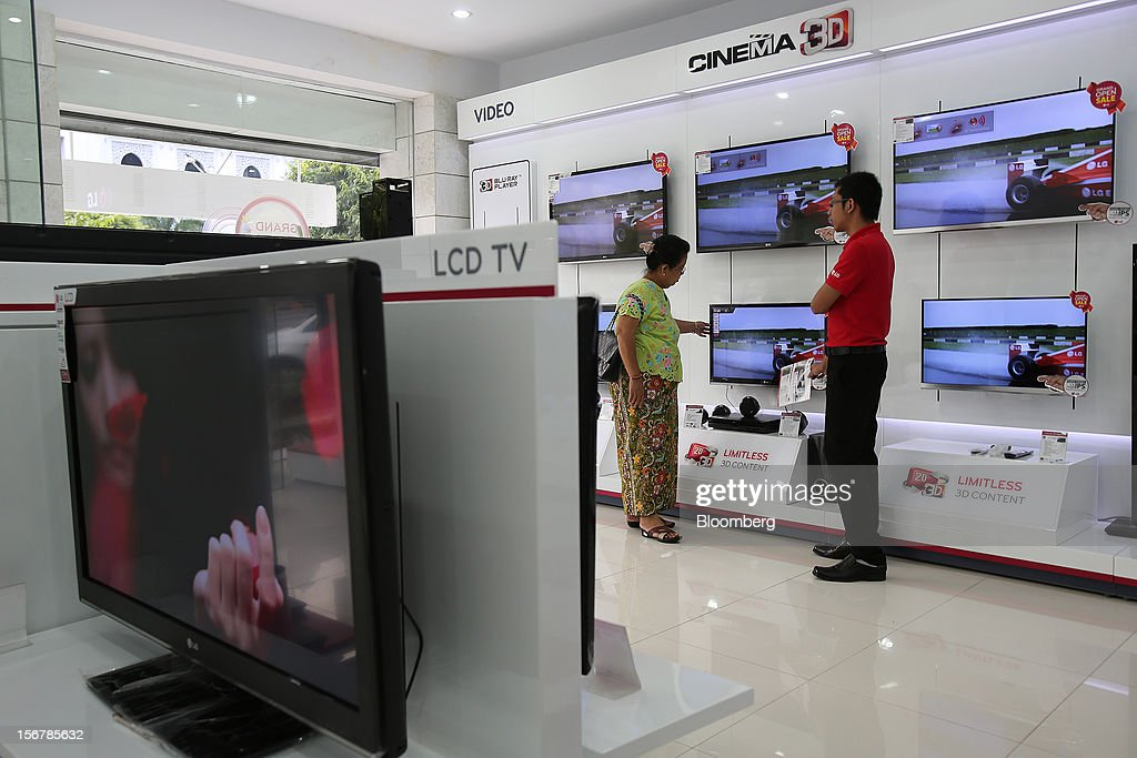 LG Electronics Inc. televisions are displayed for sale at the company's retail store in Yangon, Myanmar, on Tuesday, Nov. 20, 2012. Myanmar's growth outlook has improved 'substantially' amid political reforms, which are expected to lead to a large influx of foreign investment, the Organization for Economic Cooperation and Development (OECD) said on Nov. 18. Photographer: Dario Pignatelli/Bloomberg via Getty Images