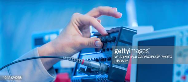 electronics measuring equipment - oscilloscope stock pictures, royalty-free photos & images