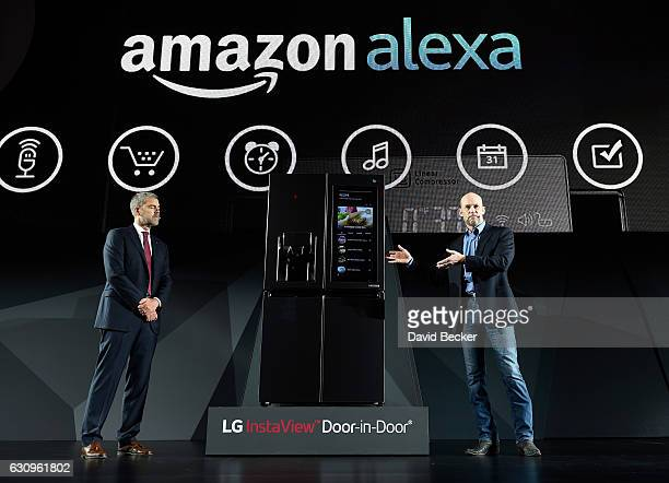 Electronics USA Vice President of Marketing David VanderWaal and Amazon Vice President of Alexa Echo and Appstore Mike George display the LG Smart...