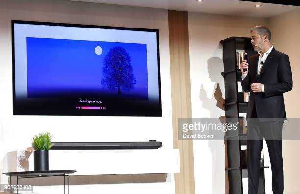 Electronics USA Vice President of Marketing David VanderWaal demostrates with a LG AI Signature OLED televison during a LG press event for CES 2018...