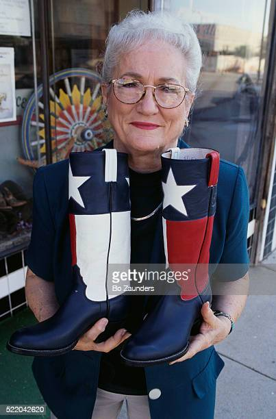 eleene mercer holding cowboy boots - san angelo texas stock pictures, royalty-free photos & images