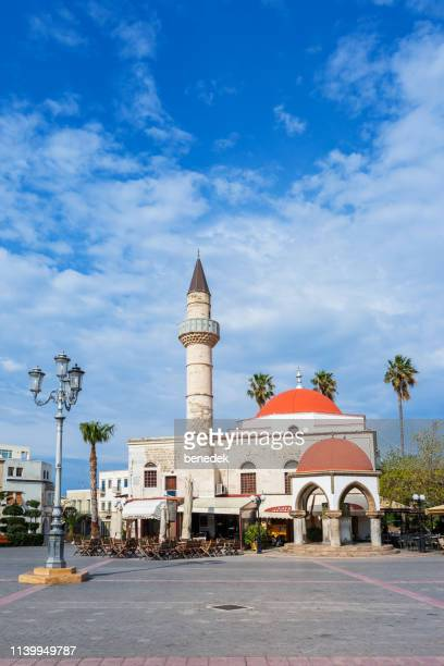 eleftherias square in downtown kos greece - mosque stock pictures, royalty-free photos & images