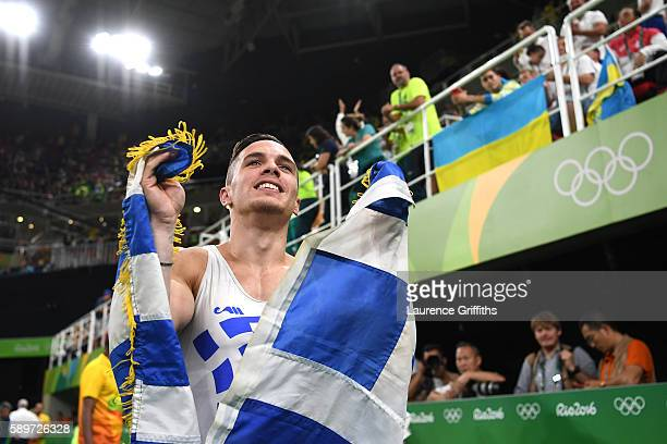 Eleftherios Petrounias of Greece celebrates winning the gold medal in the Men's Rings on day 10 of the Rio 2016 Olympic Games at Rio Olympic Arena on...