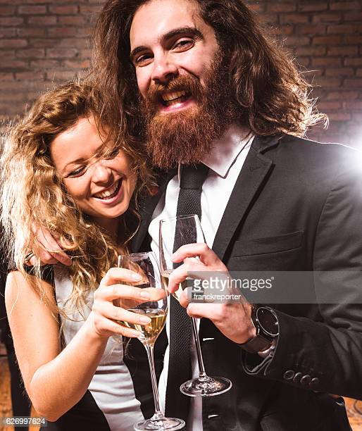Elegance couple at the party toasting