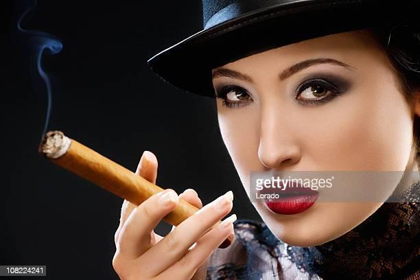 elegance - beautiful women smoking cigars stock photos and pictures