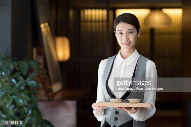 elegance waitress holding two cups of tea - tea room stock pictures, royalty-free photos & images
