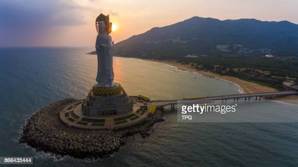 A elegant 108 meters high Guanyin Statue standing divinely under the sunset on 25th October 2017 in Sanya Hainan China