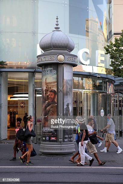 Elegant advertising column with film placard in Nice, France