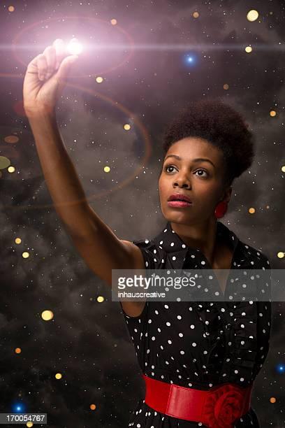 Elegant Afro American Female reaching for the stars