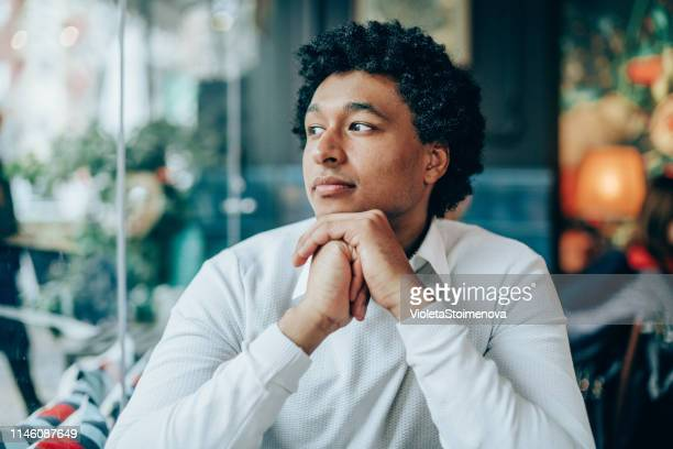 elegant afro-american man in cafe - one man only stock pictures, royalty-free photos & images