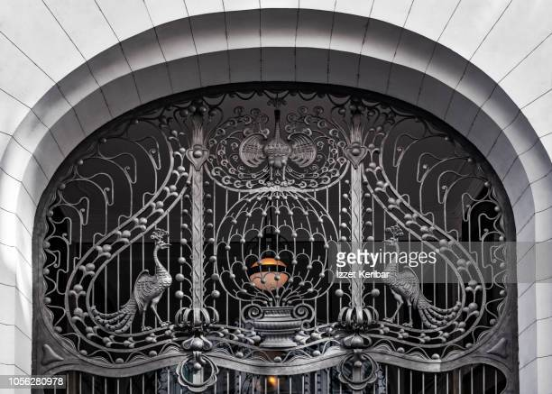 Elegant Art Nouveau style ron work on the main door of a hotel in Budapest, Hungary