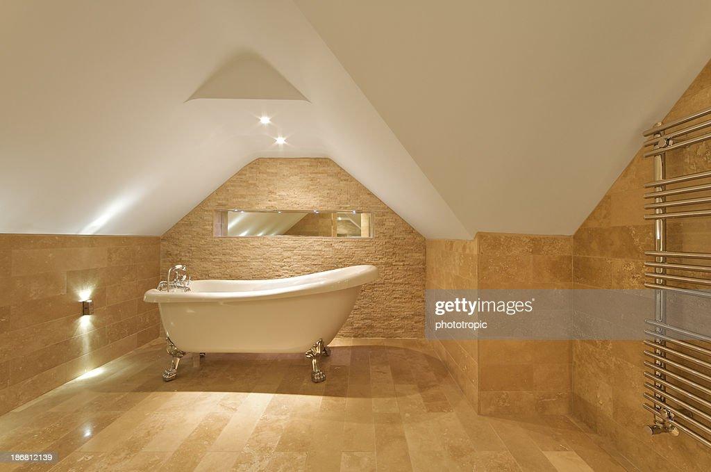 elegant attic bath and towel rail : Stock Photo