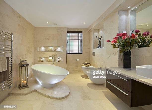 elegant bathroom with flowers - bathroom stock photos and pictures