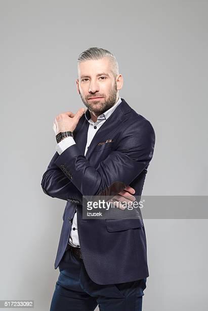 Elegant bearded grey hair businessman, Studio Portrait