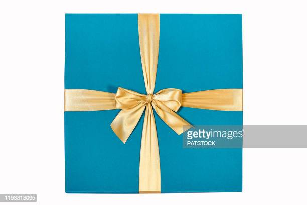 elegant blue cardboard gift box with a golden bow - gifts stock pictures, royalty-free photos & images