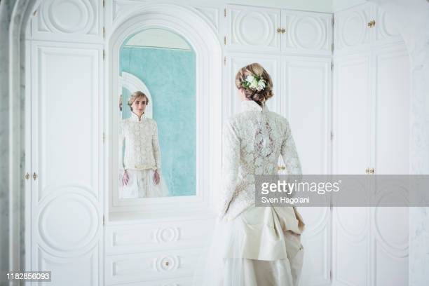 elegant bride in lace wedding dress at mirror - puerto del carmen stock pictures, royalty-free photos & images
