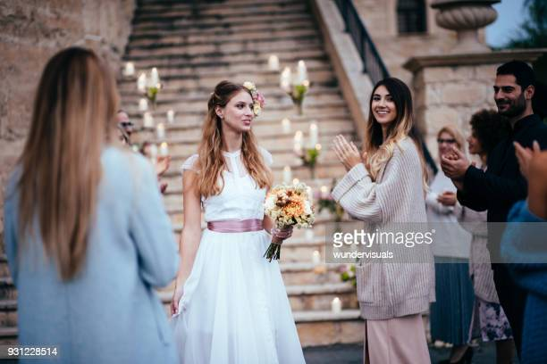 elegant bride walking among guests at wedding ceremony - wedding guest stock pictures, royalty-free photos & images