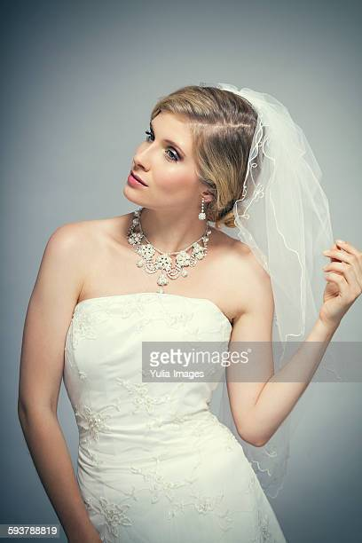 Elegant Bride Wearing Veil Looking to the Side
