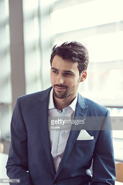 elegant businessman in the office - izusek stock photos and pictures