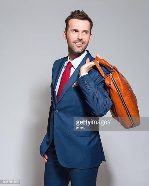 Elegant businessman wearing suit, holding briefcase