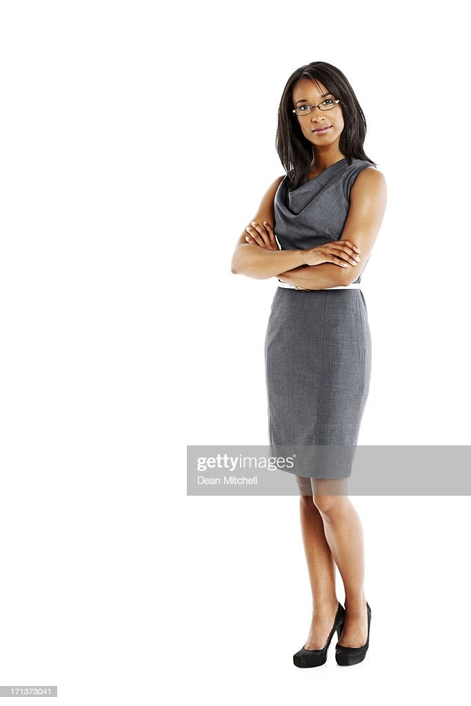 Elegant businesswoman with arms crossed : Stock Photo
