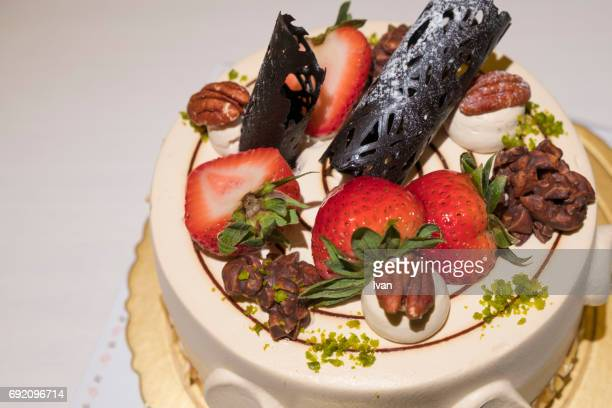 elegant caramel cake with strawberry, chocolate and nㄋㄧ - birthday cake stock photos and pictures