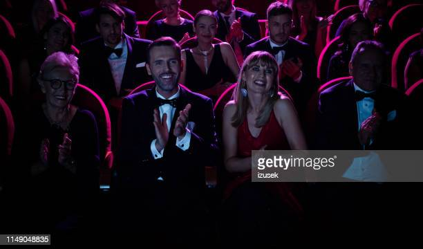 elegant couple clapping while watching opera - opera stock pictures, royalty-free photos & images