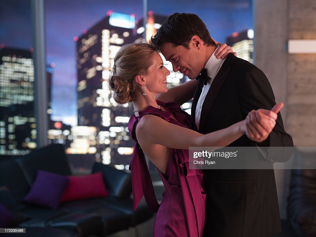 Elegant couple dancing in living room : Stock Photo