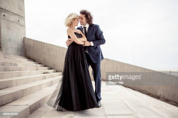 elegant couple dancing together - long dress stock pictures, royalty-free photos & images