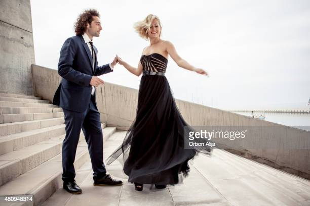 elegant couple dancing together - evening gown stock pictures, royalty-free photos & images