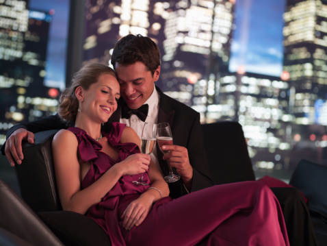 Elegant couple drinking Champagne at night - gettyimageskorea