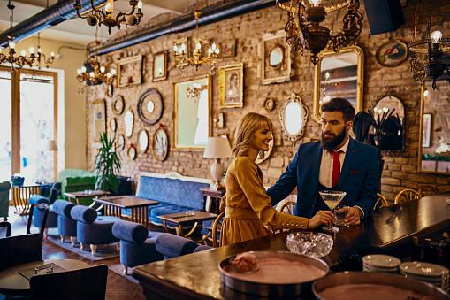 Elegant couple having a drink in a bar - gettyimageskorea