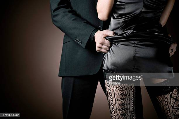 elegant couple - woman bum stock photos and pictures