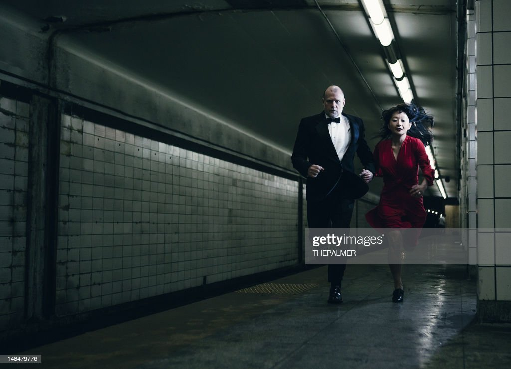 elegant couple running : Stock Photo