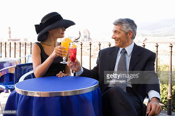 Elegant couple toasting, Florence, Italy
