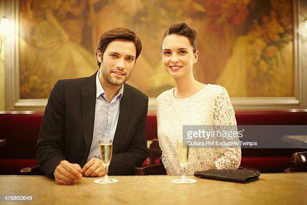 Elegant couple with champagne in restaurant