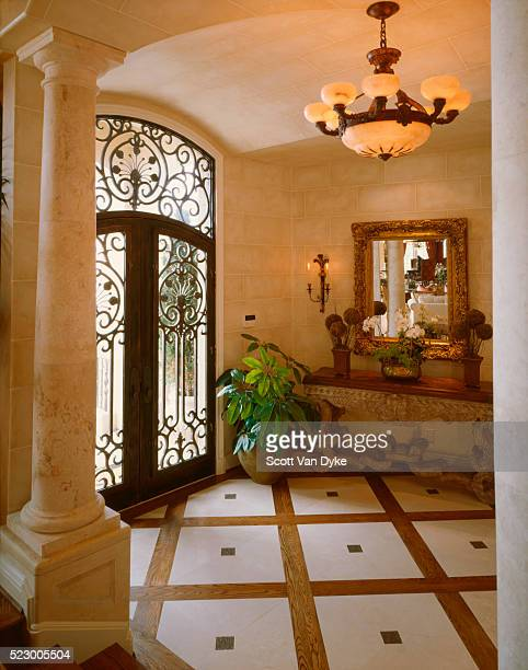 elegant entrance with scrolled metal door - scrollen stock pictures, royalty-free photos & images