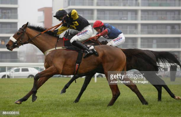 Elegant Escape ridden by Harry Cobden lead Black Corton ridden by Bryony Frost before going on to win The Ladbrokes John Francombe Novices' Steeple...