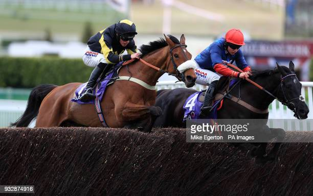 Elegant Escape ridden by jockey Harry Cobden and Black Corton ridden by jockey Bryony Frost compete in the RSA Insurance Novices' Chase during Ladies...
