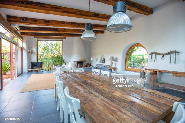 elegant farmhouse dining room, living room in barcelona - spanish culture stock pictures, royalty-free photos & images