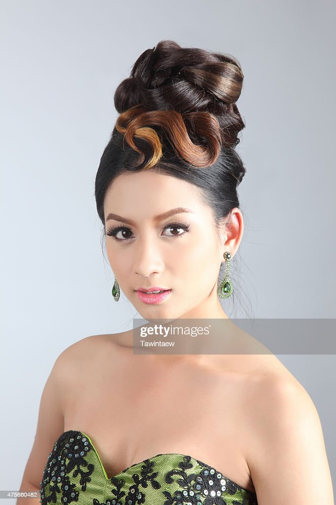 Elegant Fashion Brunette Thai Woman Posing With Creative Chignon Hairstyle High Res Stock Photo Getty Images