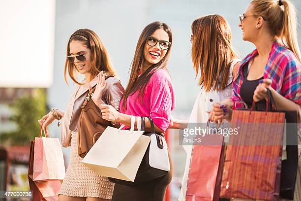 Elegant female friends shopping in the city.