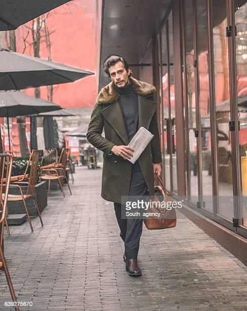 Elegant gentleman with a bag